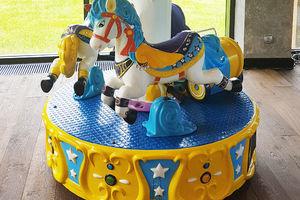 Карусель в детской игровой комнате